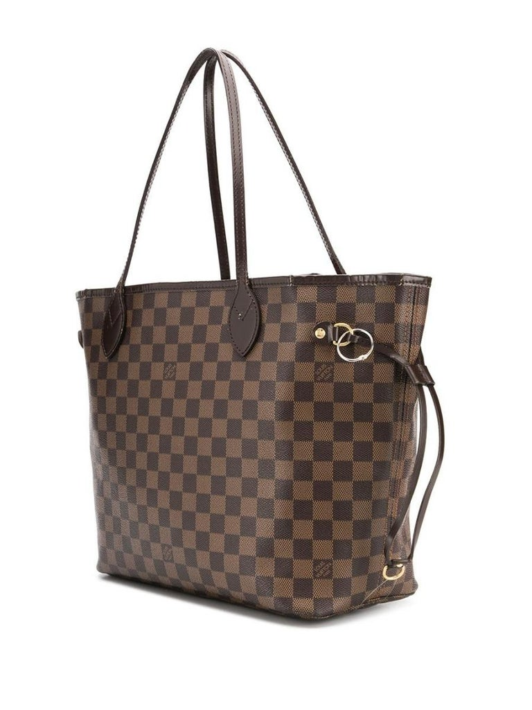Crafted in France from brown monogram leather, this iconic Neverfull MM tote tote Bag features round top handles, a drawstring fastening and a contrasting red-striped canvas lining which is accented by the the classic Louis Vuitton floral motif. The