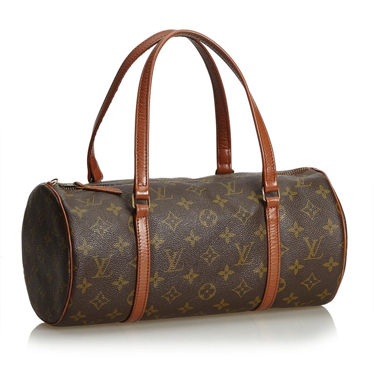 The Papillon 30 features the Monogram canvas, flat leather shoulder straps and trim, and a top zip closure. It carries as B condition rating.  Inclusions:  This item does not come with inclusions.   Louis Vuitton pieces do not come with an