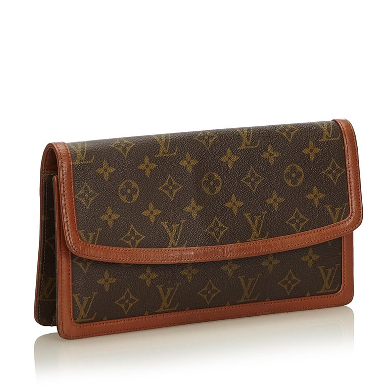 The Pochette Dame features a monogram canvas body with a leather trim, a front flap with a magnetic closure, and interior zip and open pockets. It carries as B+ condition rating.  Inclusions:  This item does not come with inclusions.   Louis Vuitton