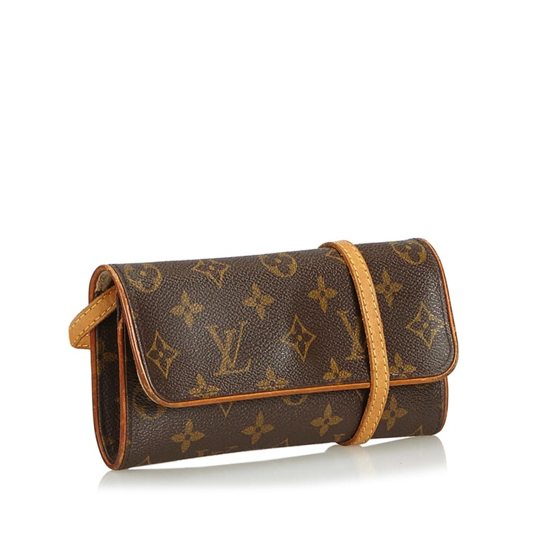 The Pochette Twin PM features a monogram canvas body, a flat shoulder strap, a front flap with a magnetic closure, and an interior slip pocket. It carries as B condition rating.  Inclusions:  This item does not come with inclusions.   Louis Vuitton