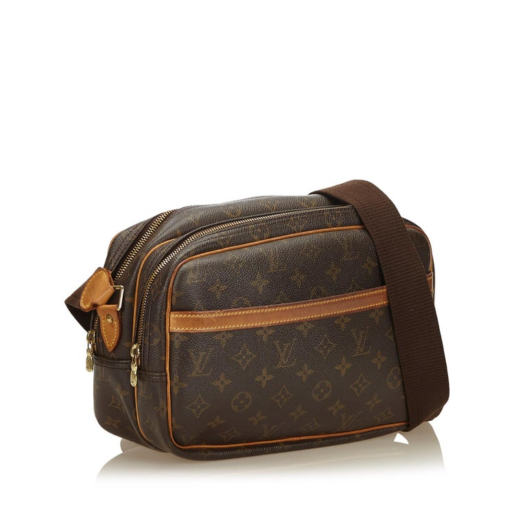 The Reporter PM features a monogram canvas body, an exterior slip pocket, top zip closures, and interior compartments. It carries as B condition rating.  Inclusions:  This item does not come with inclusions.   Louis Vuitton pieces do not come with