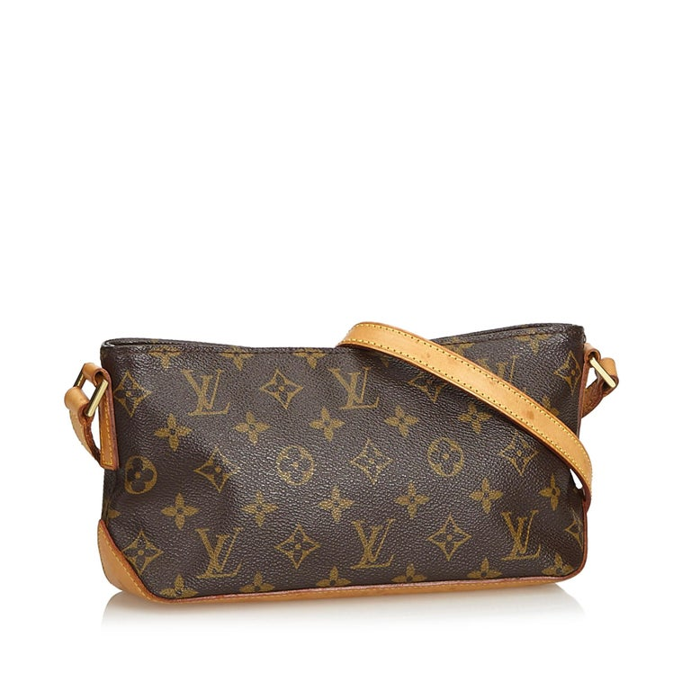 The Trotteur features a monogram canvas body, flat vachetta strap, top zip closure, and an interior zip pocket. It carries as B condition rating.  Inclusions:  Dust Bag   Louis Vuitton pieces do not come with an authenticity card�please refer to the