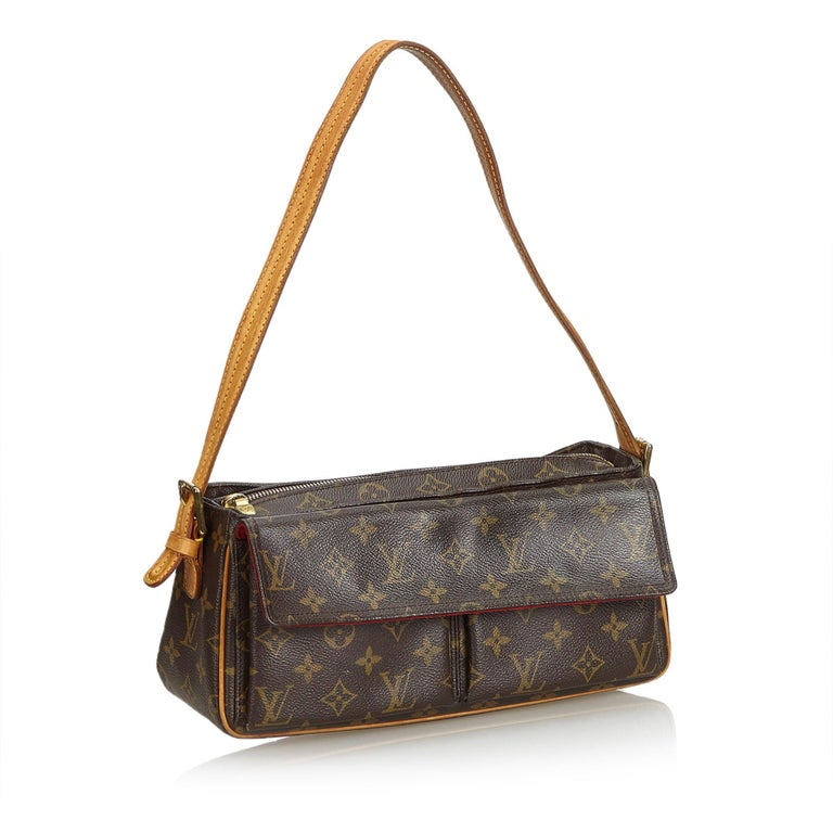 The Viva Cite MM features a monogram canvas body, an adjustable leather shoulder strap, exterior flap pockets, a top zip closure, and an interior slip pocket. It carries as B condition rating.  Inclusions:  This item does not come with