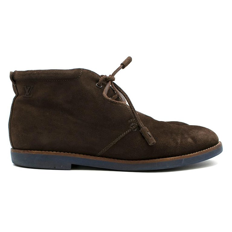 Louis Vuitton Brown Suede Ankle Boot Shoes   Brown soft suede ankle boots, Lace up design, Iconic LV logo along the ankle of boots, Louis Vuitton logo on the tongue of the shoes    Dust bag included.   Please note, these items are pre-owned and may