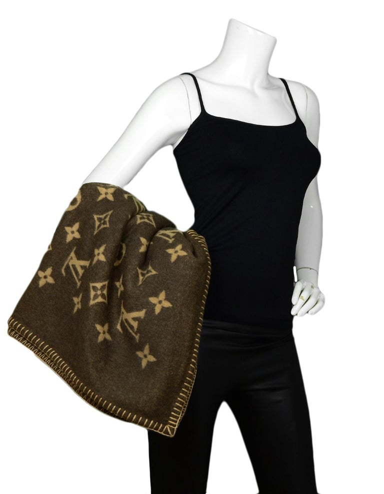 Louis Vuitton Brown Wool & Cashmere Neo Monogram Throw Blanket  Made In: United Kingdom Color: Brown, Tan Materials: 90% Wool, 10% Cashmere Overall Condition: Excellent pre-owned condition Estimated Retail: $1,420  Measurements:  54