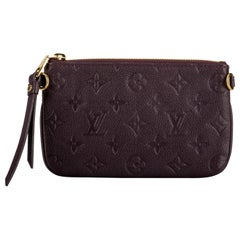 Louis Vuitton Burgundy Logo Embossed Pouchette Bag