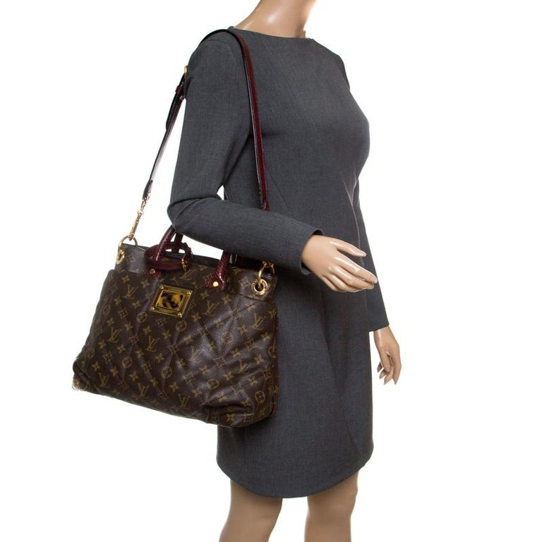 The luxurious and rare edition of the Etoile Exotique bag from Louis Vuitton is crafted in signature LV monogram canvas and has a quilted exterior. High on style and functionality, it is equipped with Bordeaux Python Toron top handles and a