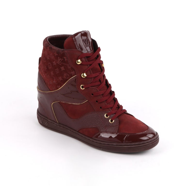 LOUIS VUITTON c.2014 Burgundy Bordeaux Monogram Suede Cliff Top Wedge Sneakers   Estimated Retail Price: $855.00   Brand / Manufacturer: Louis Vuitton  Style: Wedge Sneakers Color(s): Burgundy and gold  Unmarked Materials: Rubber (sole); leather