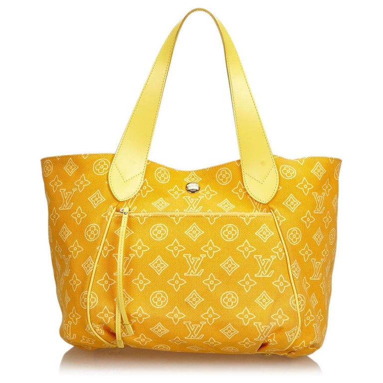 The Cabas Ipanema features a canvas body, exterior front zip pocket, flat leather straps, open top with hook closure, and interior zip pockets.  The must-have tote for Summer 2009, Cabas Ipanema combines comfort and versatility, it would sure look