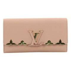 Louis Vuitton Capucines Wallet Metal Floral Edge Taurillon Leather