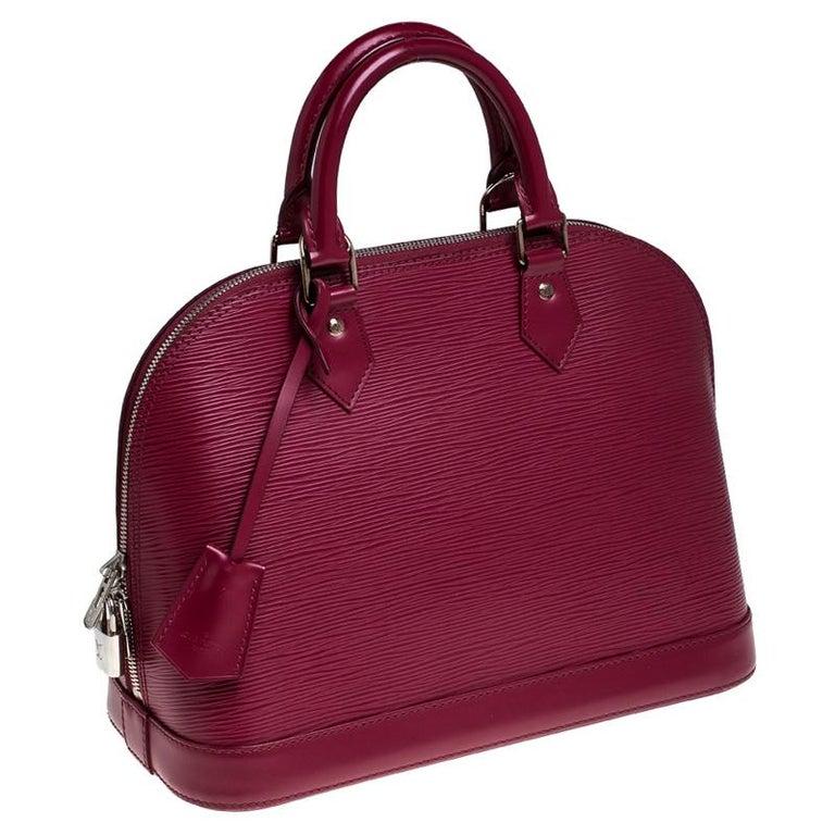 Louis Vuitton Carmine Epi Leather Alma PM Bag In Good Condition For Sale In Dubai, Al Qouz 2