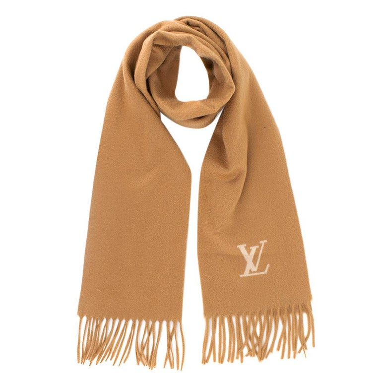 Louis Vuitton Cashmere Camel Scarf   - Scarf by Louis Vuitton. - This warm camel brown scarf looks gorgeous and elegant with every outfit and skin tone  - Light Beige 'LV' initials on the front  - 100% Cashmere  - Fringed finish at both ends of the