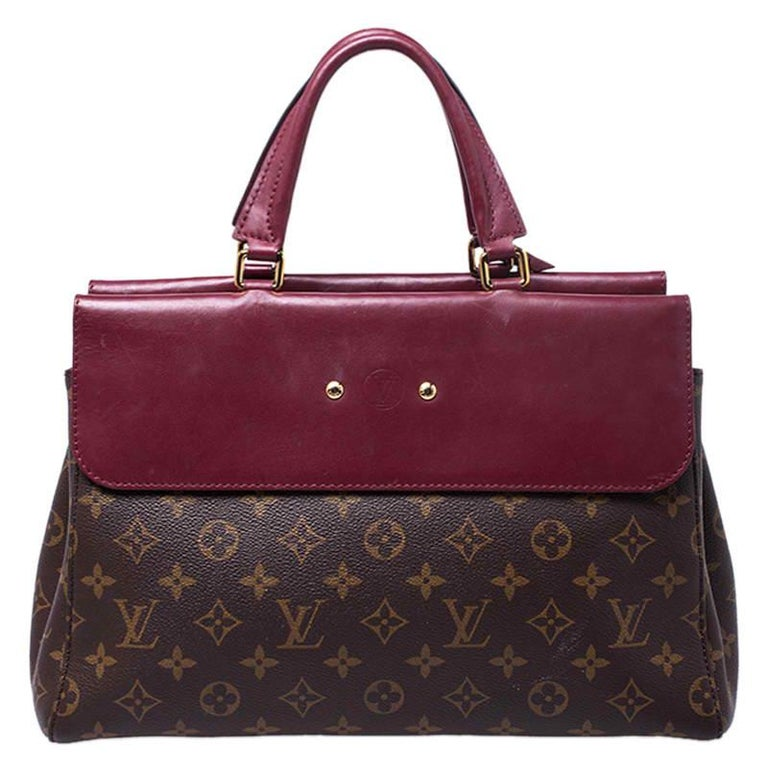 This Venus bag by Louis Vuitton has been crafted meticulously in France and is made from the brand's signature Cerise monogram canvas and red leather. The bag has a structured silhouette and features dual top handles, an Alcantara interior equipped