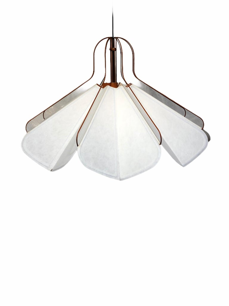 Very rare chandelier by Louis Vuitton circa 2012, in new condition with original box. The electrical system is not included in the original box. I used a black cable for the photos, you can put the color you want.