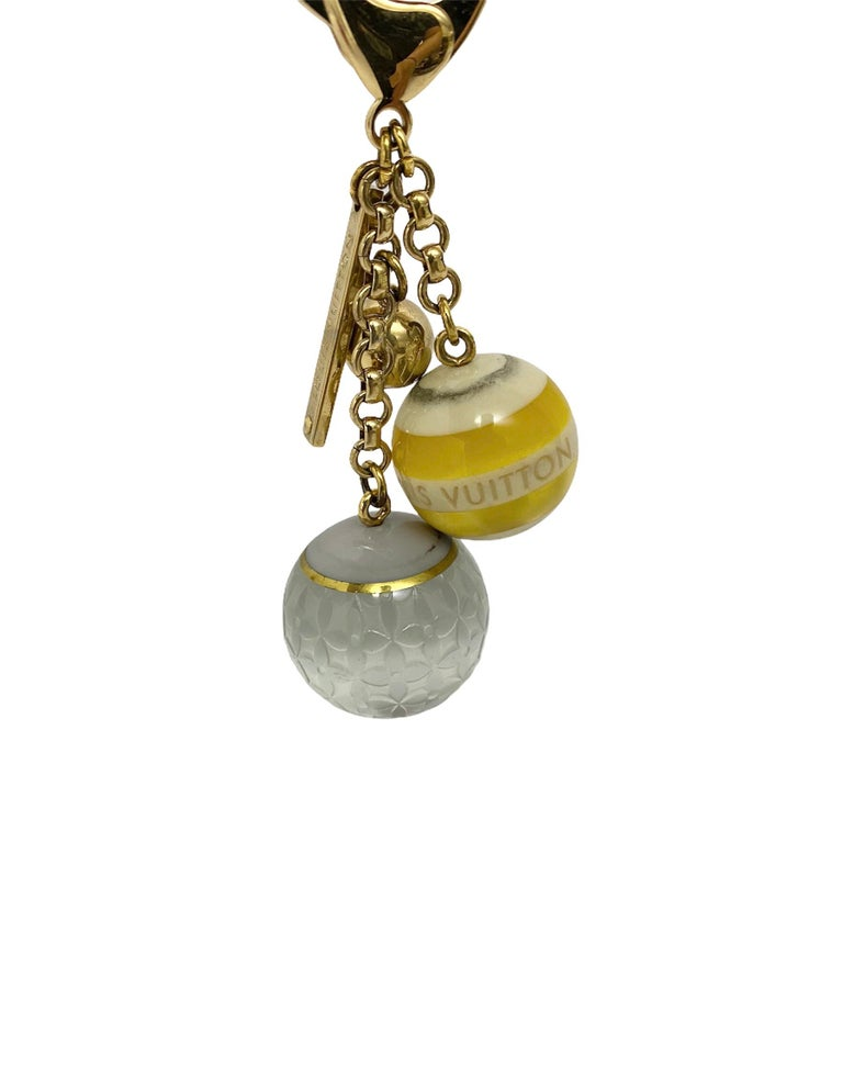 Louis Vuitton signature charm, made with golden hardware.