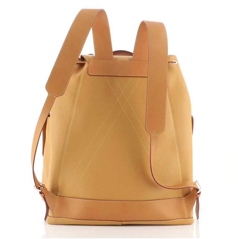 Louis Vuitton Christopher Backpack Vachetta Leather with white hardware, two slip pockets, zipper pocket and snap closure.  Height 19