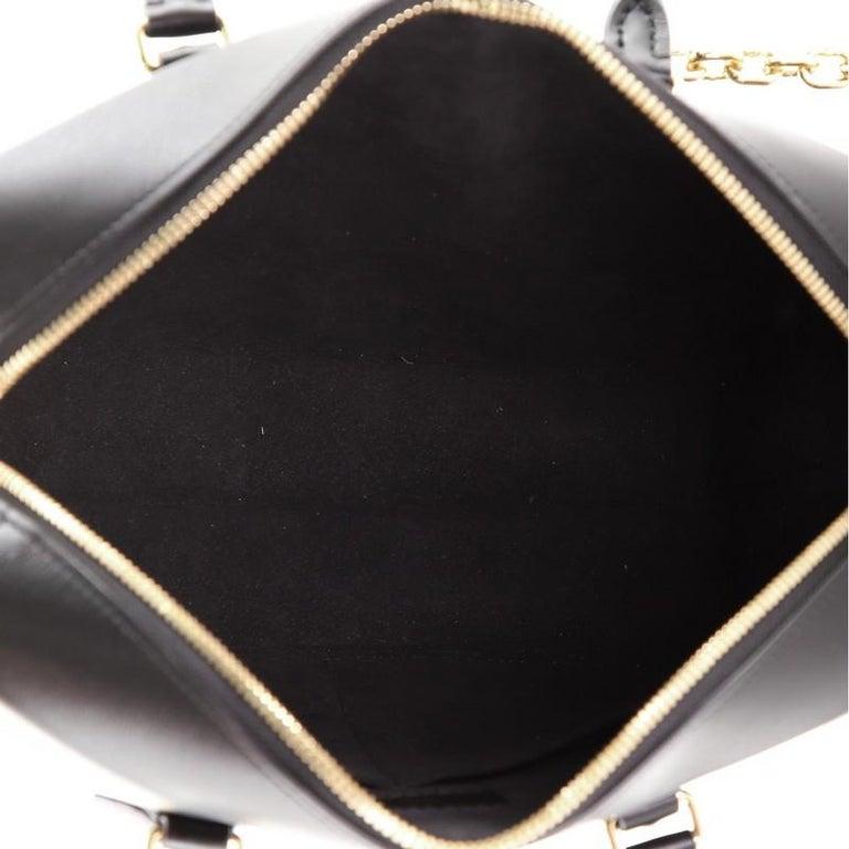 Women's or Men's Louis Vuitton City Malle Handbag Reverse Monogram Canvas and Leather MM For Sale