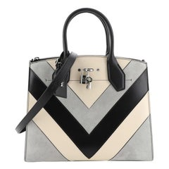 Louis Vuitton City Steamer Handbag Suede And Leather Chevron MM