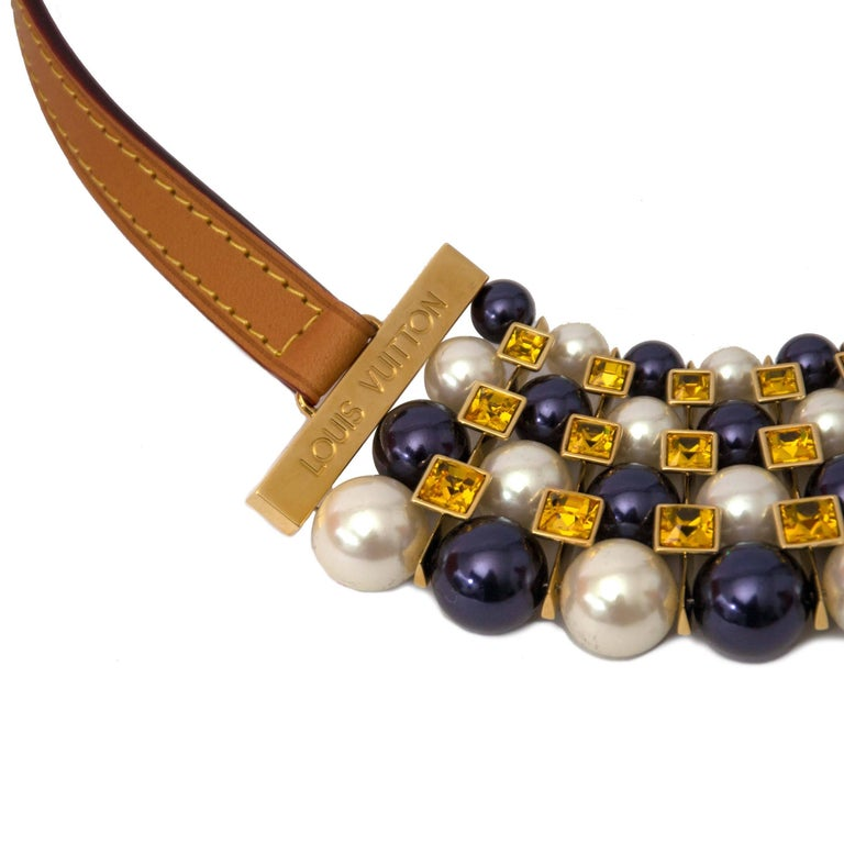 As new Louis Vuitton Collier Pearls and Crystals  Looking to spice up that one particular outfit? This gorgeous Louis Vuitton necklace will do the trick!  Adorn yourself in a series of amazing white and blue pearls accompanied by birght yellow