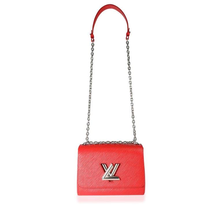 Louis Vuitton Coquelicot Epi Leather Twist Chain MM SKU: 113519 MSRP: USD 4,150.00 Condition: Pre-owned (3000) Condition Description: The Louis Vuitton Twist Bag was first created for the 2015 Cruise show collection. Coming in a coqeulicot red Epi