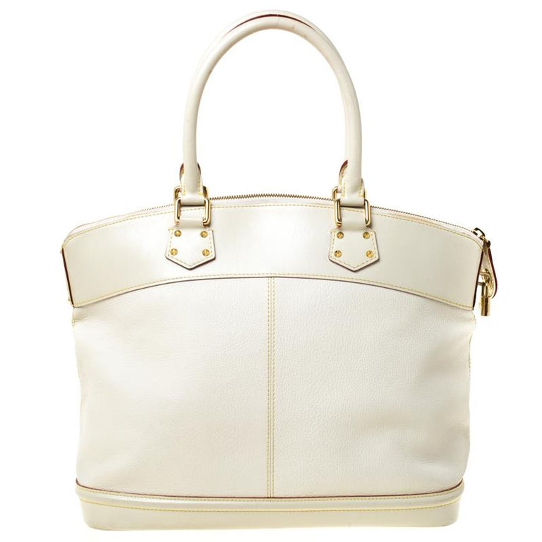 Louis Vuitton's handbags are popular owing to their high style and functionality. This Lockit bag, like all the other handbags, is durable and stylish. Crafted from Suhali leather, the bag comes with two rolled top handles and a zipper that opens to