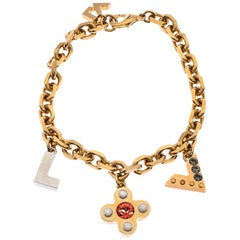 Louis Vuitton Crystal Love Letter Timeless Gold Tone Charm Bracelet