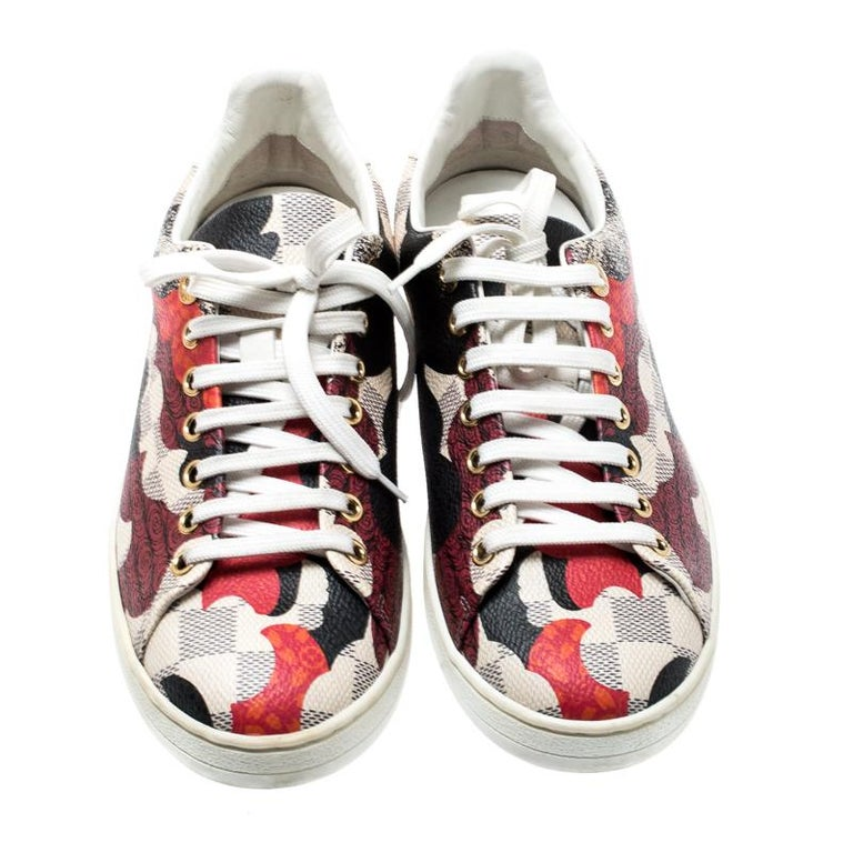 Ace the sneaker-game in this fabulous pair from Louis Vuitton! These sneakers are crafted from signature Damier Azur coated canvas and leather trims featuring a multicolored print all over. They have round toes and lace-ups on the vamps. They come