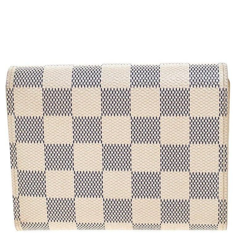 This Joey wallet from Louis Vuitton is not only good looking but also functional. Crafted from signature Damier Azur canvas this number flaunts a logo engraved push lock closure. The interior has card slots, an ID slot and a zip pocket for you to