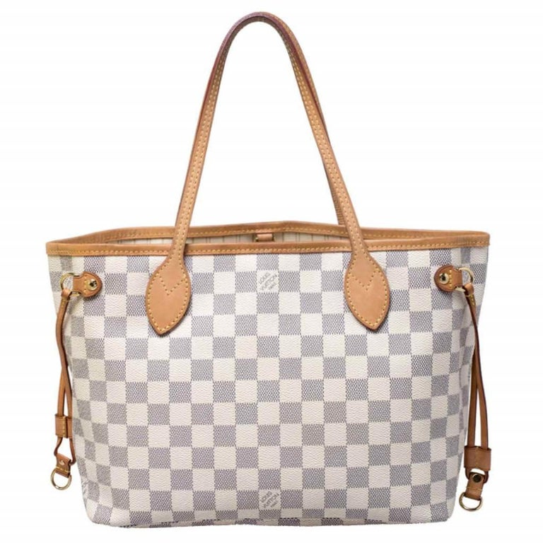 Louis Vuitton's Neverfull was first introduced in 2007, and even today it is a popular design. Crafted from Damier Azur canvas, this Neverfull is gorgeous. The bag has drawstrings on the sides, a spacious canvas interior that can house all your