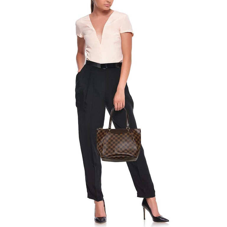Encompassing style and luxury in equal measures, this Westminster tote from Louis Vuitton is truly worth the buy. The amazing tote is crafted from the signature Damier Ebene canvas with subtle pleats and styled with dual handles that are anchored by