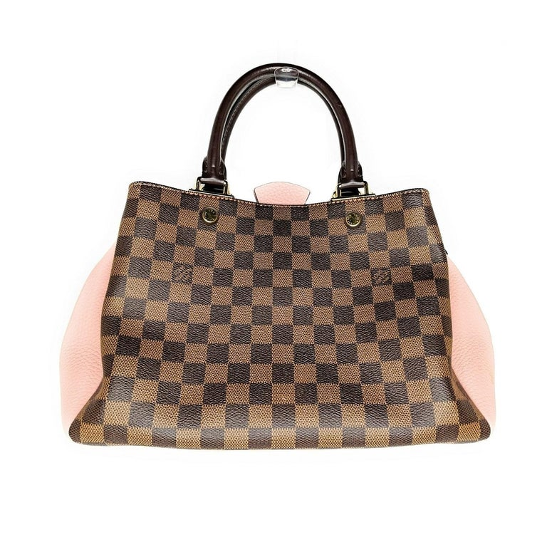 Brown and tan Damier Ebene coated canvas Louis Vuitton Brittany handle bag with brass hardware, dual rolled top handles, single detachable flat shoulder strap, pink leather trim, protective feet at base, pink Alcantara lining, three interior