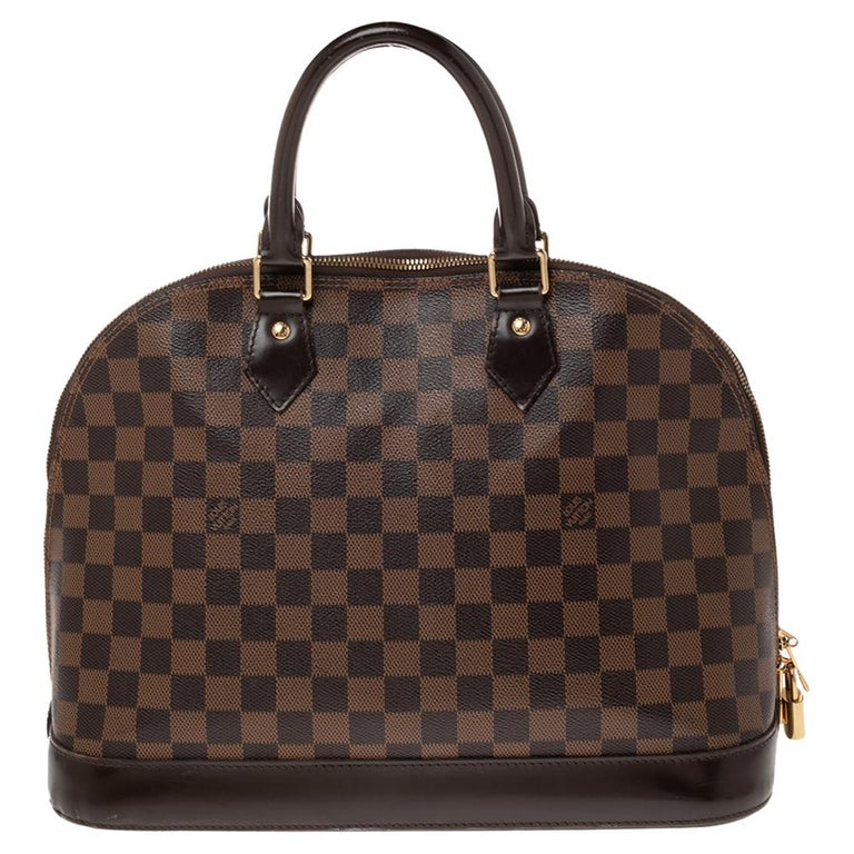 Out of all the irresistible handbags from Louis Vuitton, the Alma is the most structured one. First introduced in 1934 by Gaston-Louis Vuitton, the Alma is a classic that has received love from icons. This piece comes crafted from Damier Ebene and
