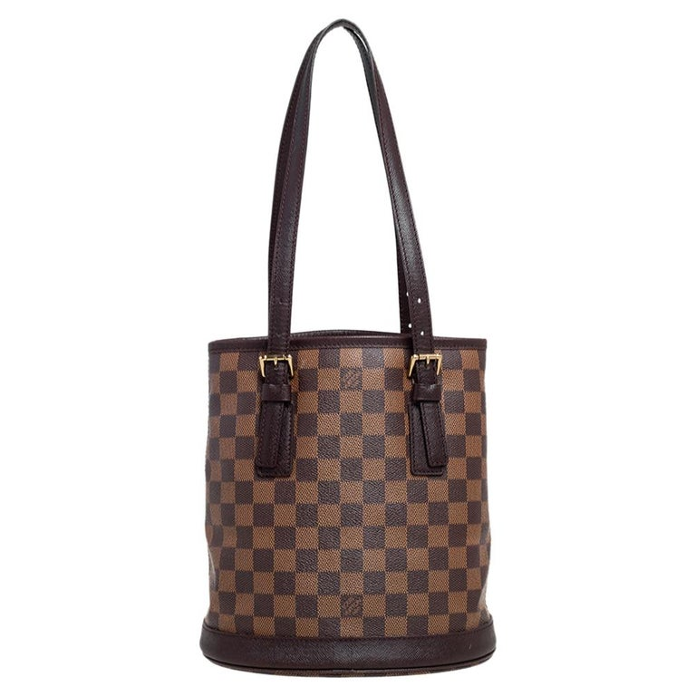 Named after the historic Le Marais district in Paris, the Marais bag is a classic design from the house of Louis Vuitton. Exuding the label's rich craftsmanship and creativity, the bag is rendered in Damier Ebene canvas and features a beautiful,