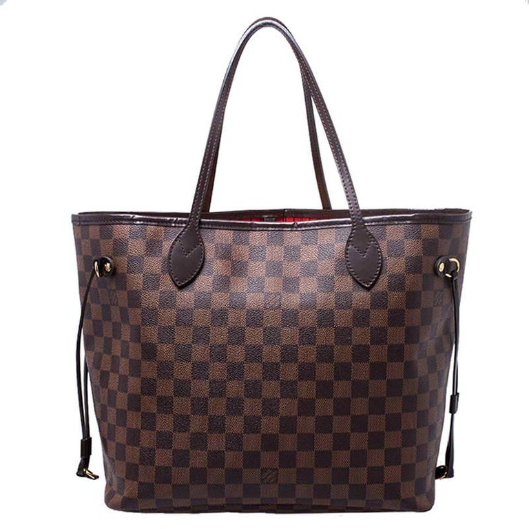 Louis Vuitton's Neverfull was first introduced in 2007, and even today it is a popular design. Crafted from Damier Ebene canvas, this Neverfull is gorgeous. The bag has drawstrings on the sides, a spacious canvas interior that can house all your