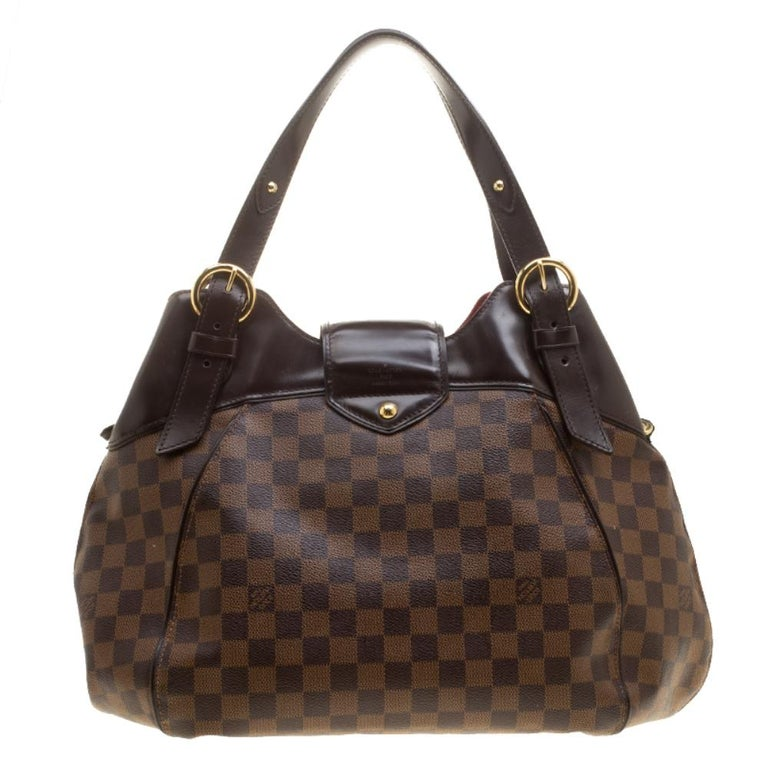 Louis Vuitton's handbags are popular owing to their high style and functionality. This Sistina GM bag, like all the other handbags, is durable and stylish. Crafted from Damier Ebene canvas and leather, the brown bag can be paraded using the top