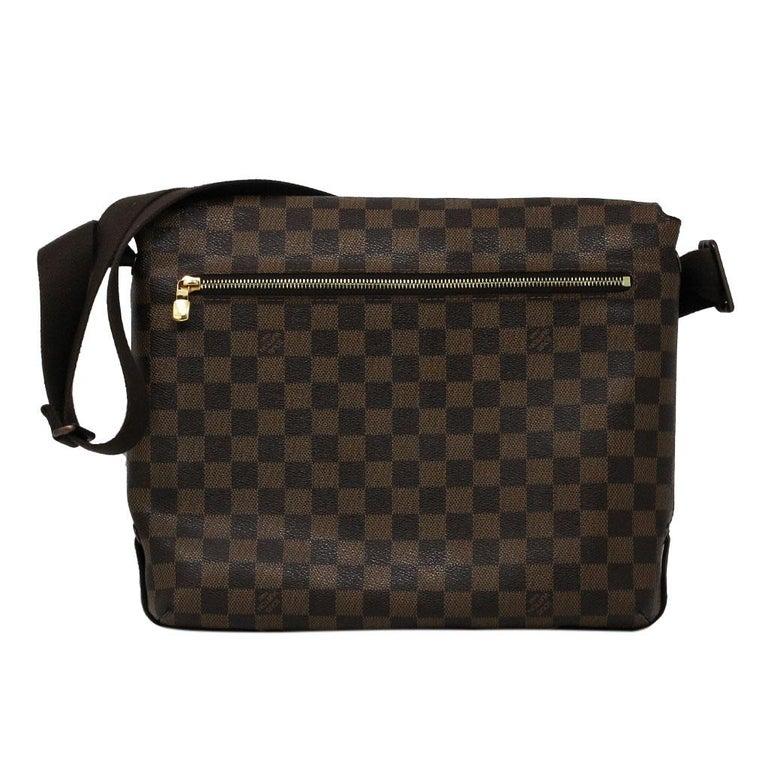Brand: Louis Vuitton Style: Messenger Bag Handles: Brown Canvas adjustable shoulder straps, Can be worn crossbody Measurements: 12.6