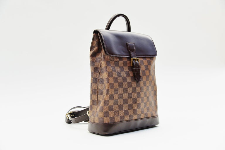 From the collection of Savineti we offer this Louis Vuitton Soho Backpack: -Brand: Louis Vuitton -Model: Damier Soho -Year: 1999 -Serial Number: TH0999 -Condition: Good -Materials: Canvas, leather, gold-tone hardware  We at Savineti sell rare