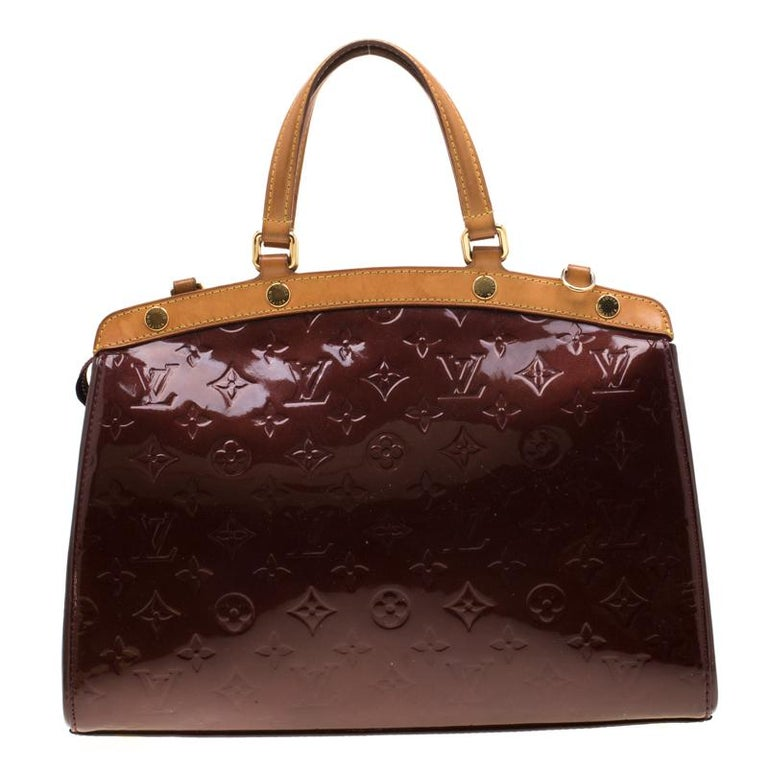 The feminine shape of Louis Vuitton's Brea is inspired by the doctor's bag. Crafted from the iconic Monogram Vernis the bag has a perfect finish. The fabric interior is spacious and it is secured by a zipper. The bag features double handles,