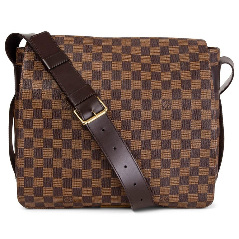 100% authentic Louis Vuitton Bastille messenger bag in Ebene brown Damier canvas with details in dark brown leather. Two pockets on the outside underneath the flap. Lined in terra cotta canvas with an open pocket against the back. Has been carried