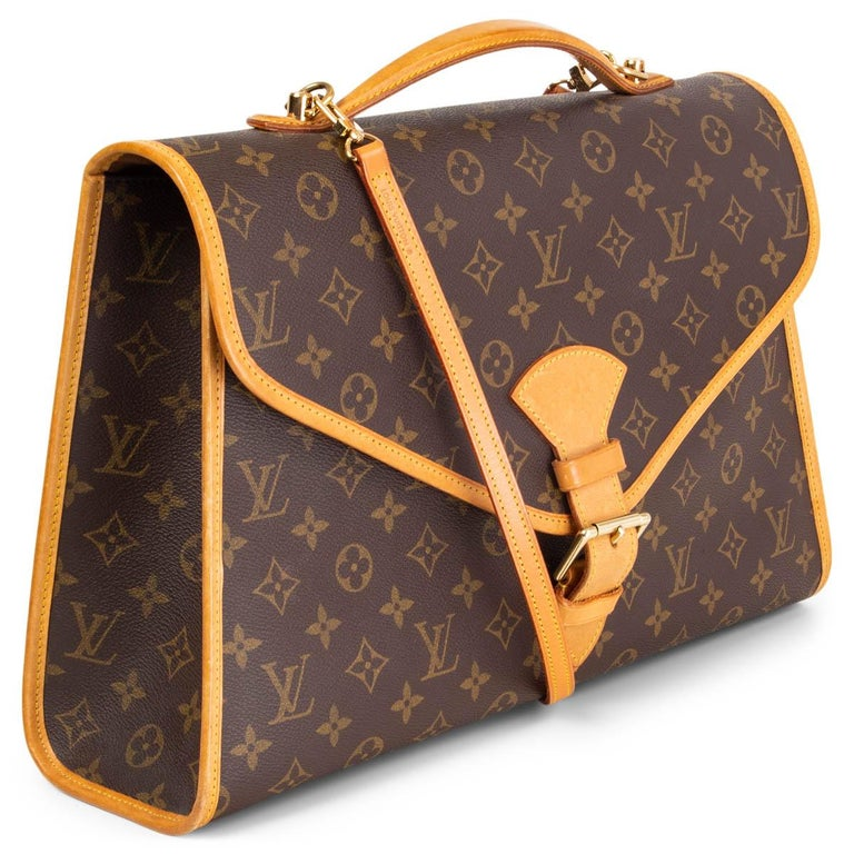 100% authentic Louis Vuitton Beverly GM briefcase shoulder bag in monogram canvas with natural leather trim. Vintage 1993. Opens with a gold-tone metal buckle at front and is lined in brown canvas with one zipper pocket against the back. Comes with