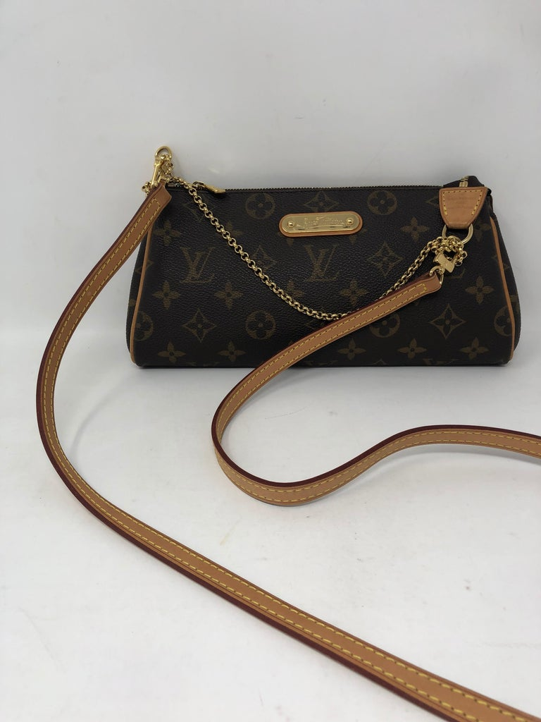 Louis Vuitton Eva Clutch. Retired from LV. Very good condition. Can be worn as a crossbody or a clutch. Guaranteed authentic.