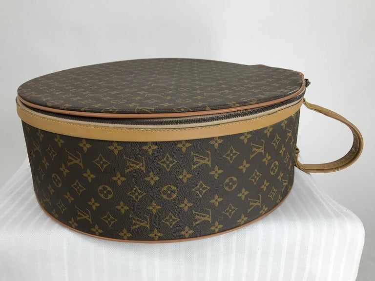 Louis Vuitton for The French Company, also labeled Saks Fifth Ave. 50cm Boite Chapeaux, round hat box. In remarkably good condition for it's age and use. Louis Vuitton logo canvas with leather welt cord and trimming outlining the zipper. Oval