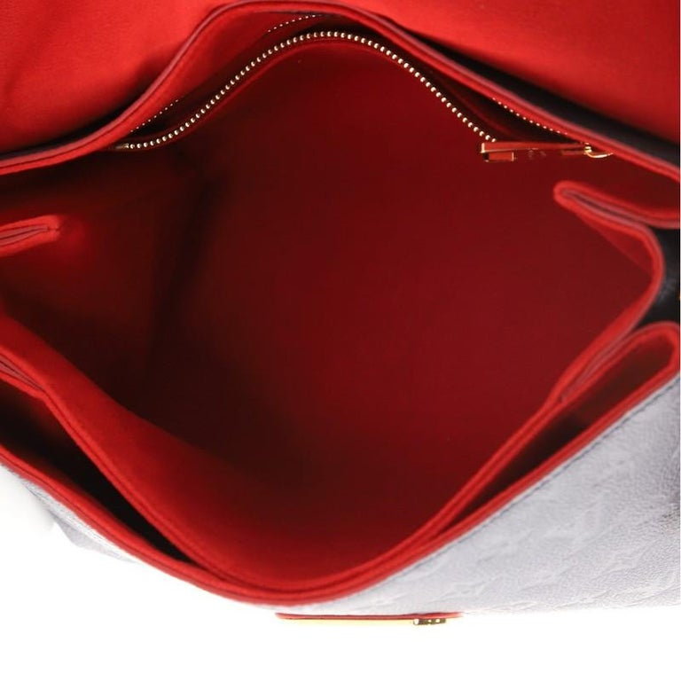 Women's or Men's Louis Vuitton Georges Handbag Monogram Empreinte Leather MM For Sale