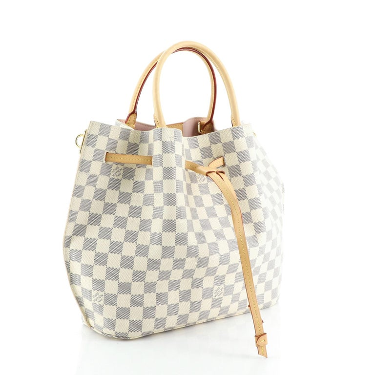 This Louis Vuitton Girolata Handbag Damier, crafted in damier azur coated canvas, features dual rolled handles and gold-tone hardware. Its drawstring closure opens to a pink microfiber interior with side zip pocket. Authenticity code reads: GI3156.