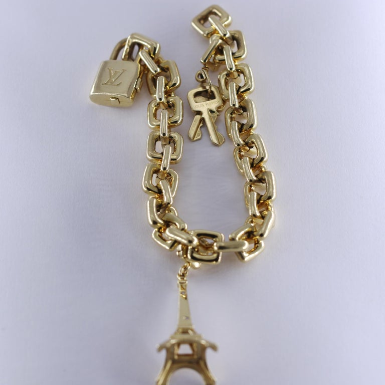 Women's Louis Vuitton Gold Charm Bracelet with Lock and Key Clasp and Eiffel Tower Charm For Sale