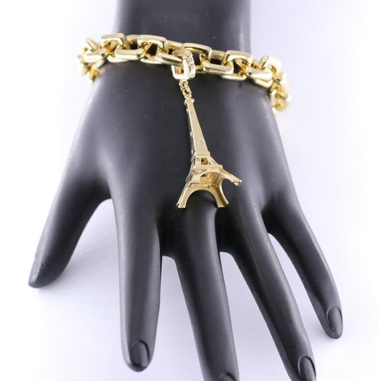 Louis Vuitton Gold Charm Bracelet with Lock and Key Clasp and Eiffel Tower Charm For Sale 1