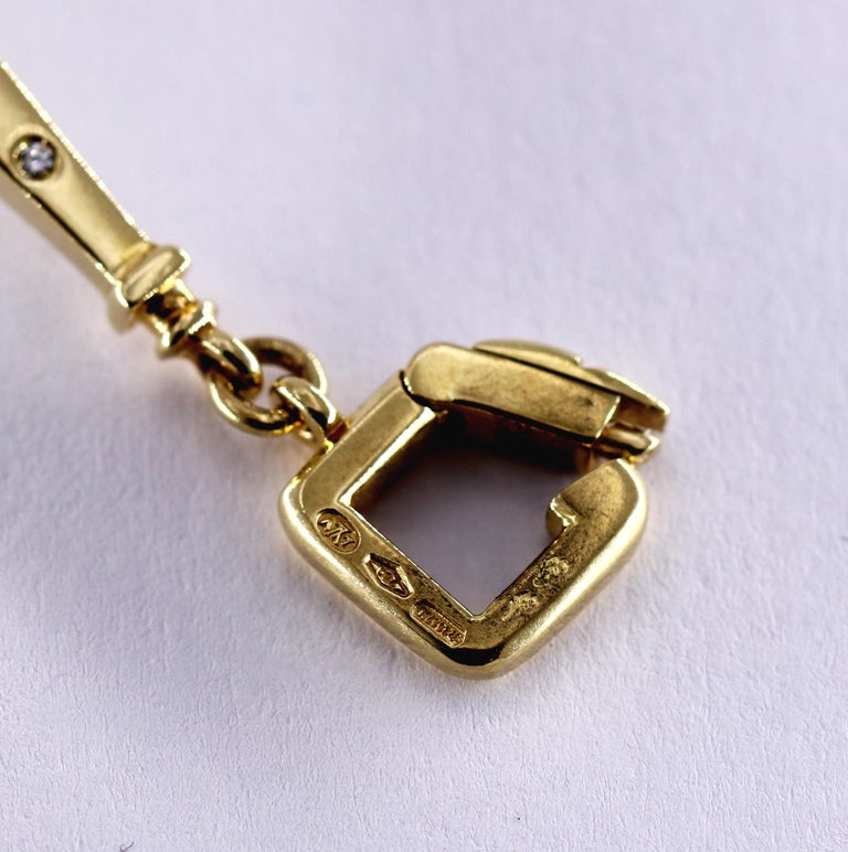 Louis Vuitton Gold Charm Bracelet with Lock and Key Clasp and Eiffel Tower Charm For Sale 3