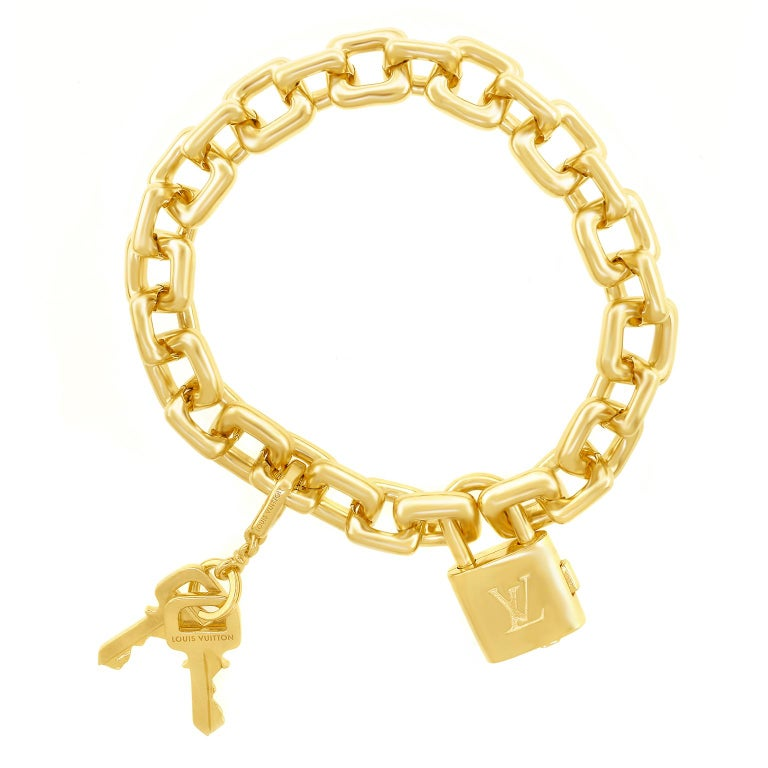 Louis Vuitton Gold Charm Bracelet with Lock and Keys In Excellent Condition For Sale In Litchfield, CT