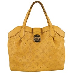 LOUIS VUITTON Gold Perforated Monogram Leather Mahina Cirrus PM Handbag