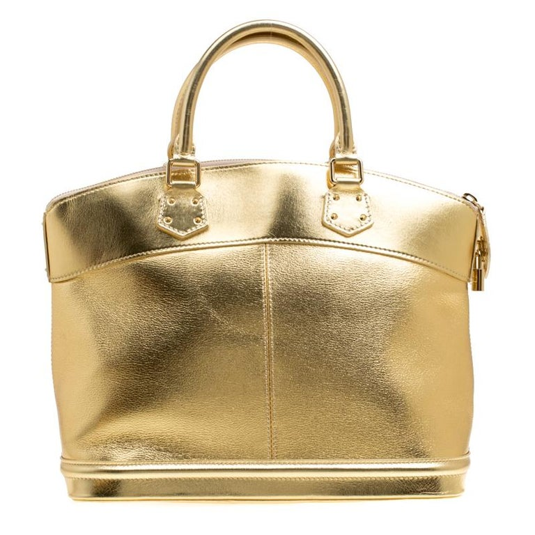 Louis Vuitton's handbags are popular owing to their high style and functionality. This Lockit bag, like all the other handbags, is durable and stylish. Crafted from gold Suhali leather, the bag comes with two rolled top handles and a zipper that